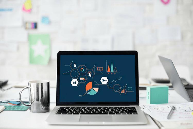 Laptop near the window showing an online strategy marketing