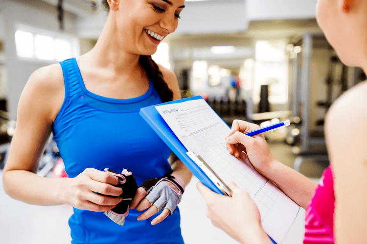 personal trainer onboarding client with consultation