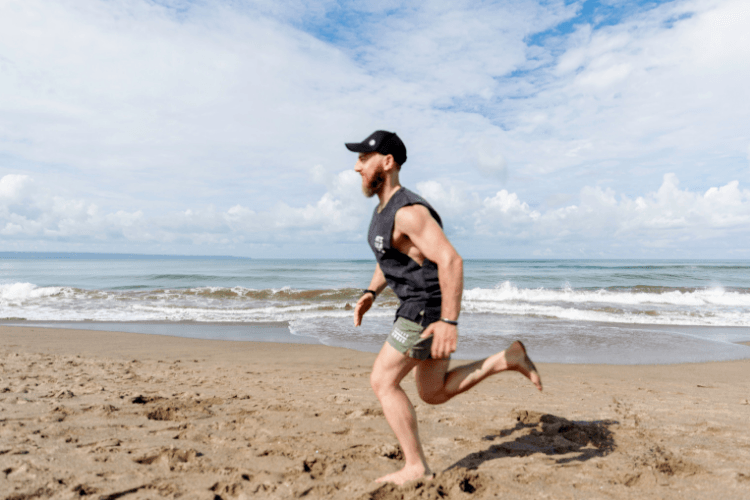 Ru Anderson running on the beach